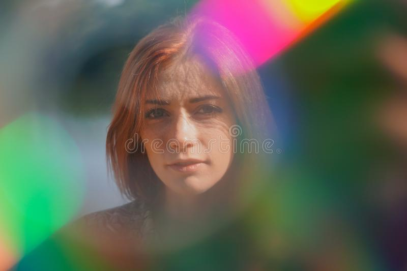 Funky portrait of a young woman with lens flare and light leaks royalty free stock photography
