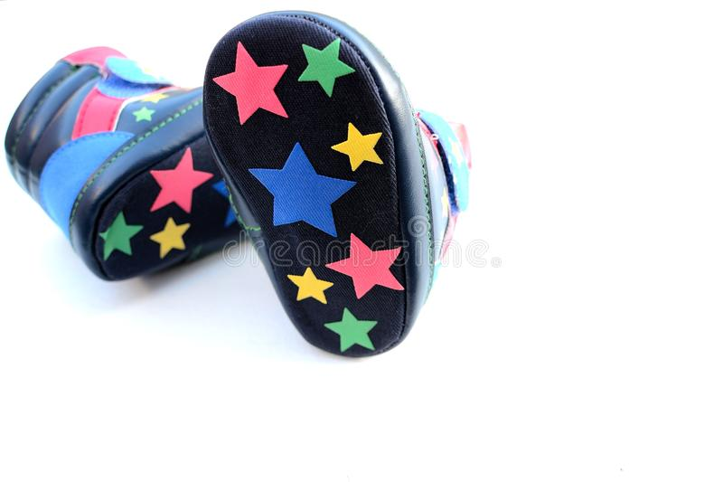 Funky toddlers shoes. On white background royalty free stock photos