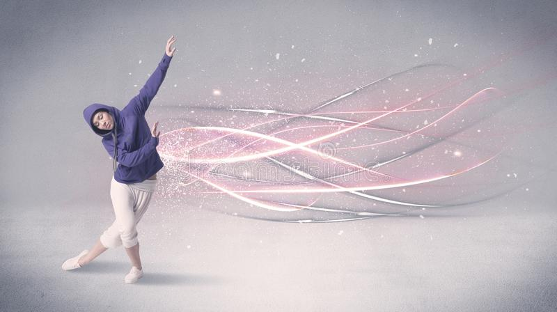 Funky urban dancer with glowing lines stock image