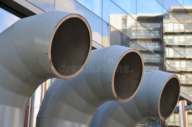 Funnel shaped ventilation ducts on a modern building royalty free stock images