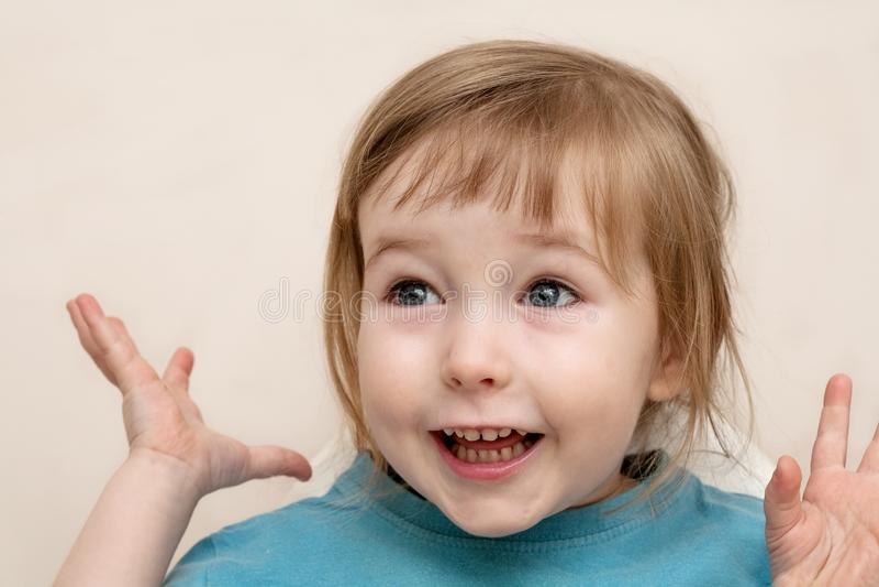Funny admiration emotional white child girl face closeup stock photos