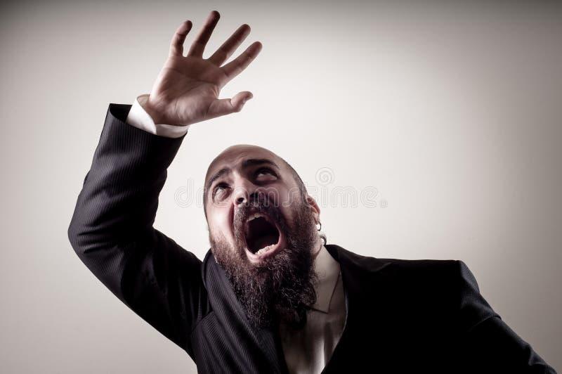Funny afraid elegant bearded man royalty free stock photo