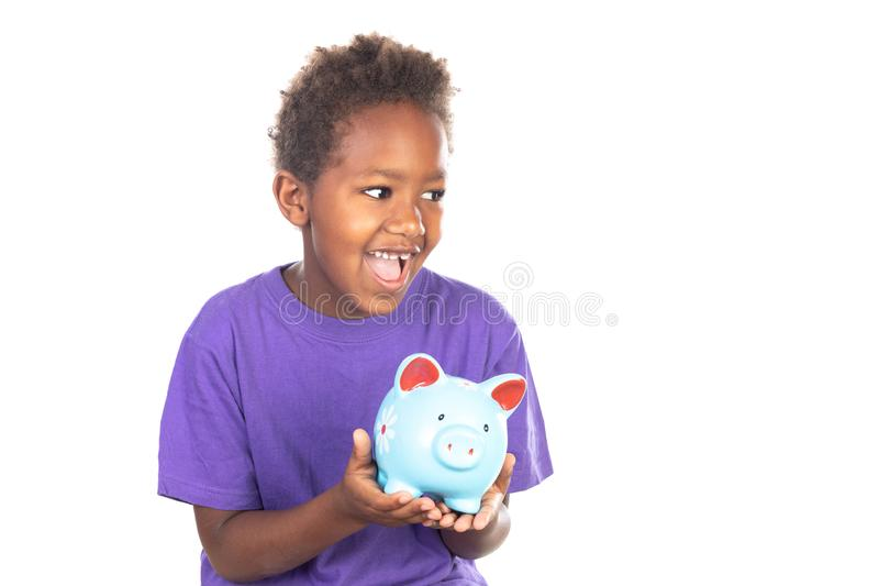 Funny african Child with a piggybank royalty free stock image