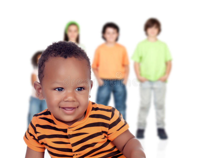 Funny afroamerican baby with other children stock photography
