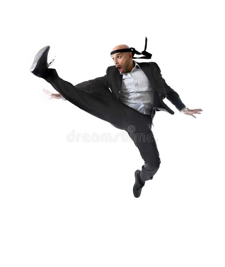 Funny aggressive businessman wearing suit jumping on the air in royalty free stock photography