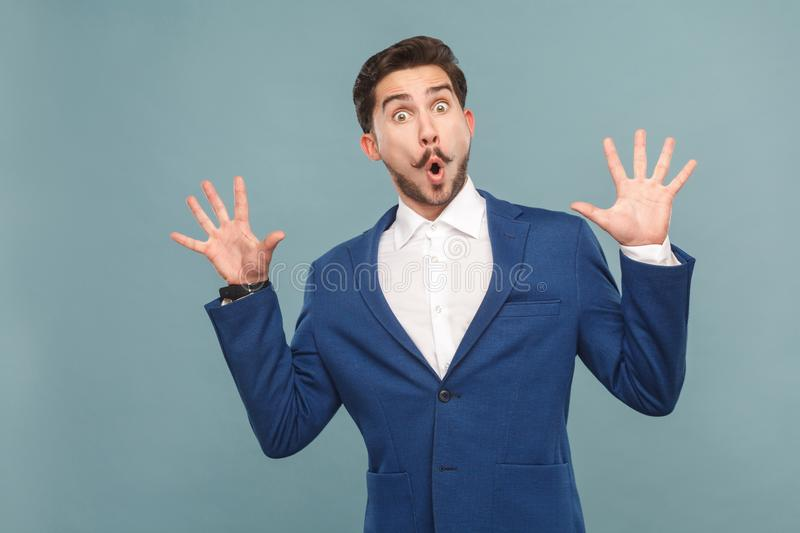Funny amazing manager open mouth, big eyes and shouting stock photo