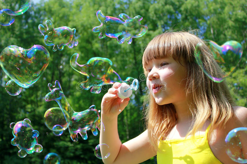 Funny animals shaped soap bubbles stock image