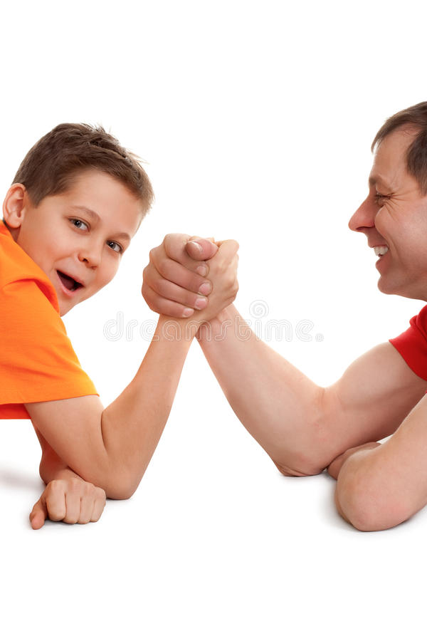 Funny arm wrestling. For father and son on white stock image