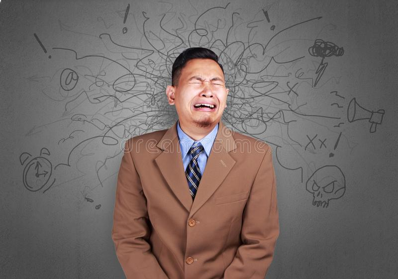 Funny Asian Businessman Crying Hard royalty free stock photo
