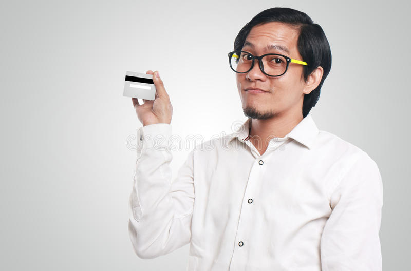 Funny Asian Man With a Credit Card royalty free stock photography