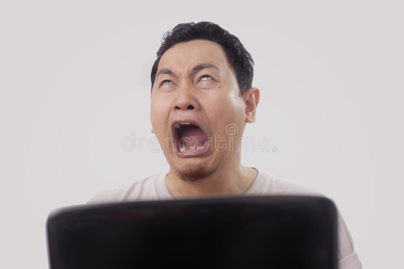 Funny Asian Man Crying stock photos