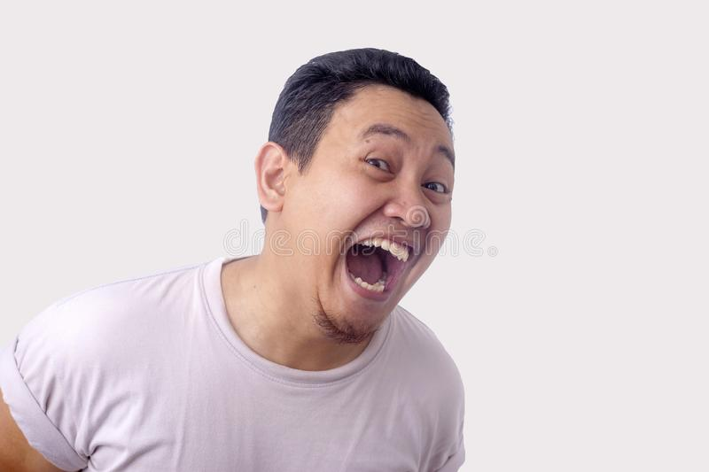 Funny Asian Man Laughing stock image