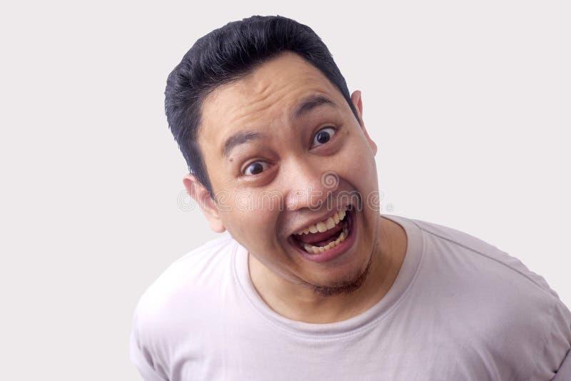 Funny Asian Man Laughing royalty free stock photos