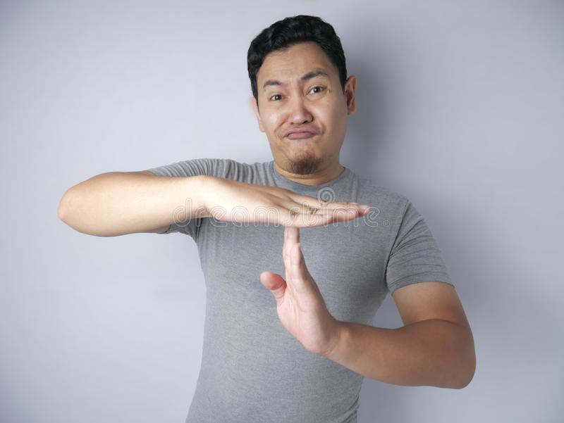 Funny Asian Man Making Time Out Gesture stock photos