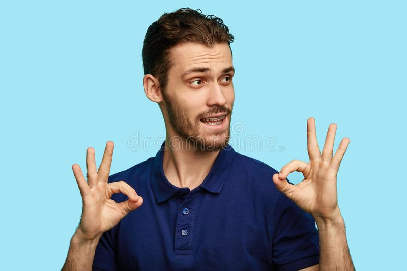 Funny attractive man showing ring sign. stock photography