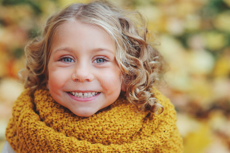 Funny autumn portrait of happy toddler girl walking outdoor royalty free stock photo