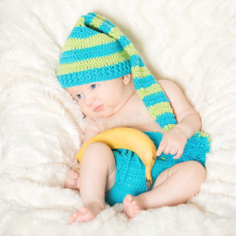 Funny baby with banana stock photography