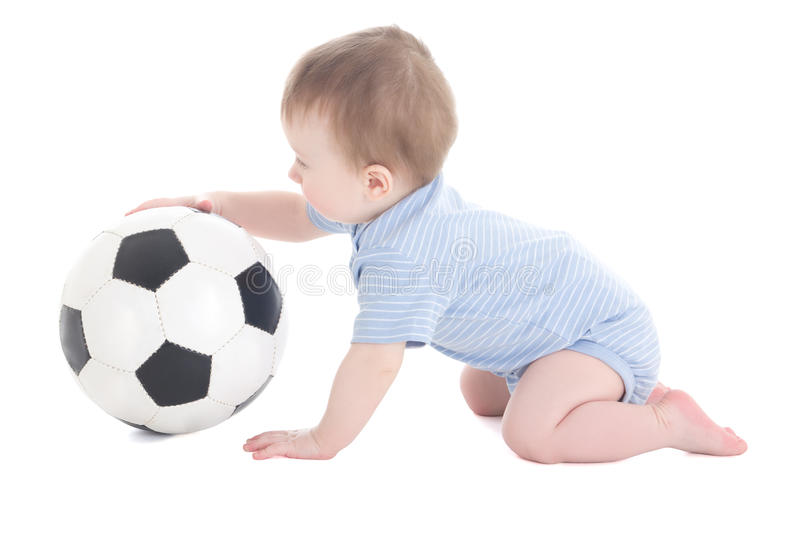 Funny baby boy toddler playing with soccer ball isolated on whit. E background stock photography