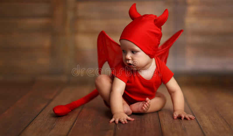download funny baby in devil halloween costume on wooden background stock photo image