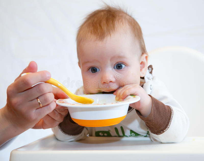 Funny baby dinner royalty free stock photography