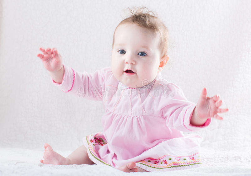 Funny baby girl giving a hug royalty free stock photo