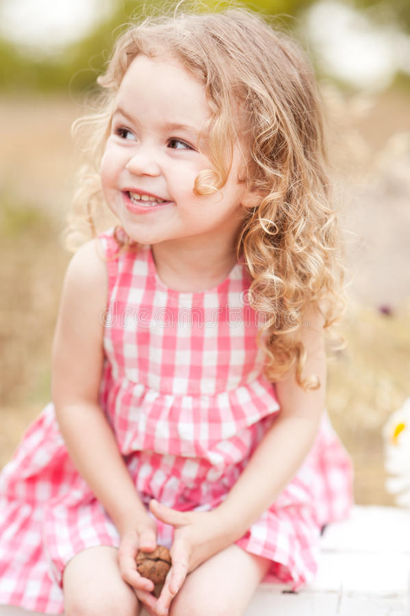 Funny baby girl outdoors stock images