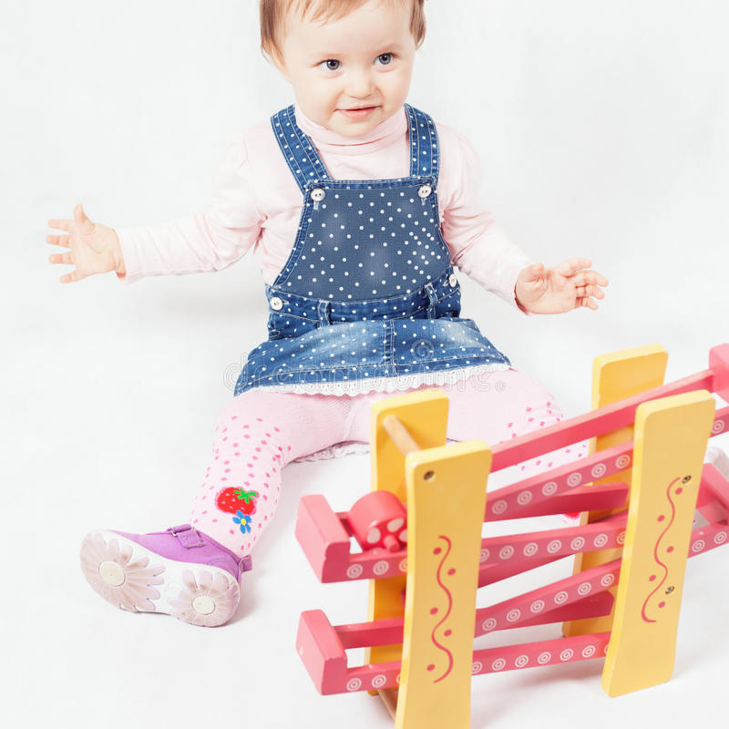 Funny baby girl playing with toy game for development royalty free stock photography