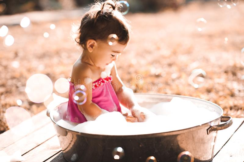 Baby girl outdoors stock images