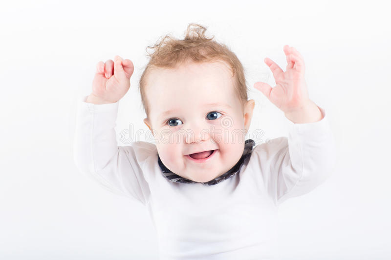 Funny baby with her hands in the air stock photos