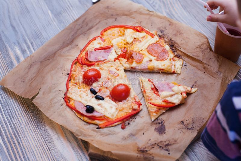 Funny baby pizza cooked in a cooking class, just from the oven, hot fresh food. stock photo
