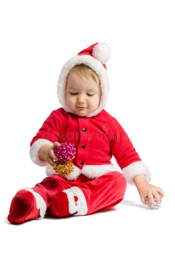 Funny baby in Santa Claus clothes and xmas decorating. On white background royalty free stock photos