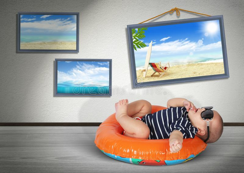 Funny baby on swimming circle at home, as on the beach. Vacation. Concept stock images