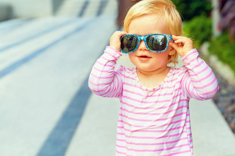 Funny baby. In a swimsuit and sunglasses stock photo