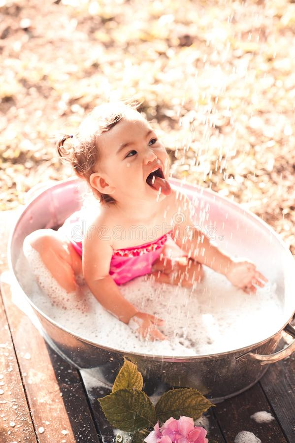 Baby girl outdoors royalty free stock image