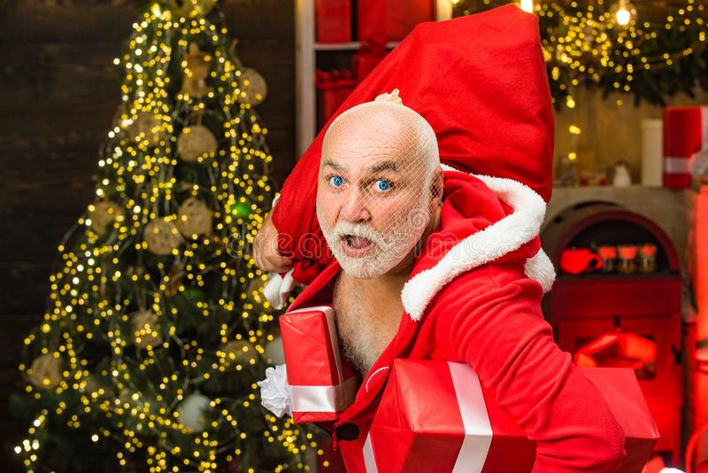 Funny bad Santa Claus with gift, bag with presents. Best prices for winter gifts. Seasonal offer. Christmas sale. stock image