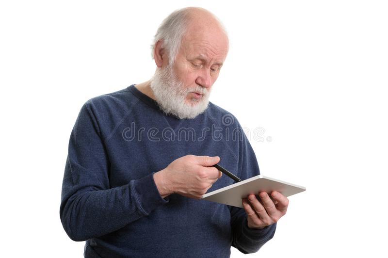 Funny old man using tablet computer isolated on white stock image
