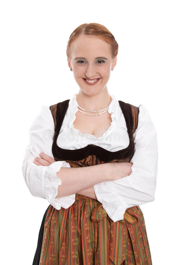 Funny bavarian girl isolated in dirndl. Funny bavarian girl smiling isolated on white royalty free stock photo