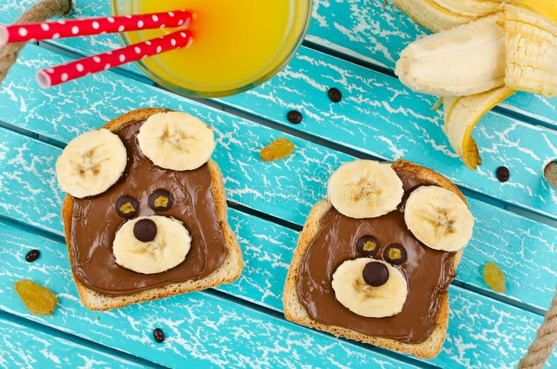 Funny bear face sandwich for kids snack food. Creative breakfast idea for kids stock images