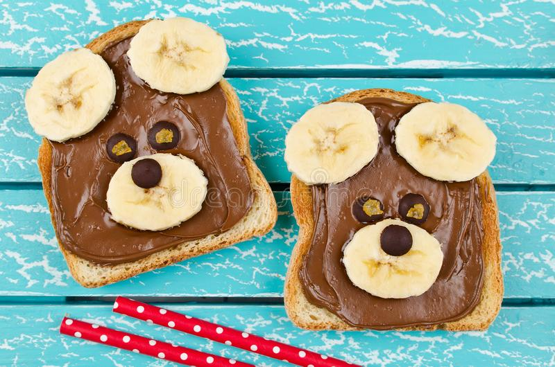 Funny bear face sandwich for kids snack food. Creative breakfast idea for kids royalty free stock image