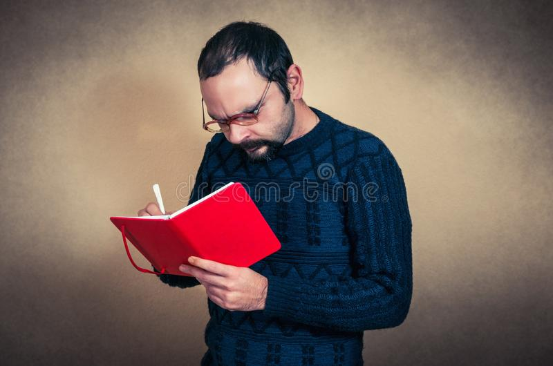 Funny bearded man with notebook royalty free stock images
