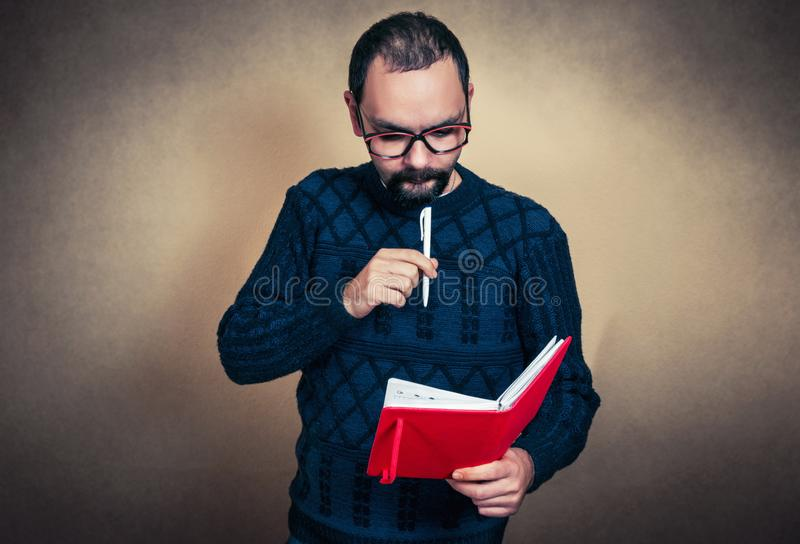 Funny bearded man with notebook stock photography
