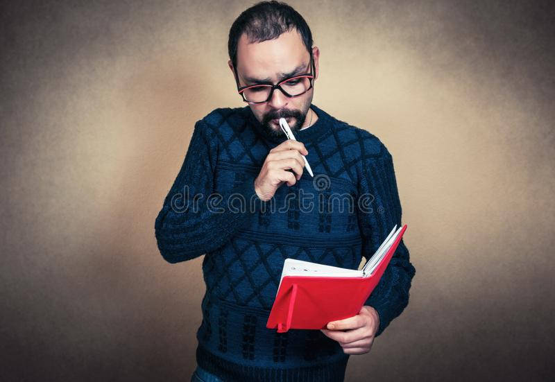 Funny bearded man with notebook royalty free stock image