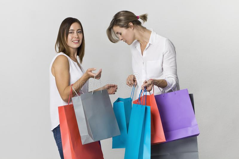 Funny beautiful attractive relaxed carefree girls with shopping stock photo
