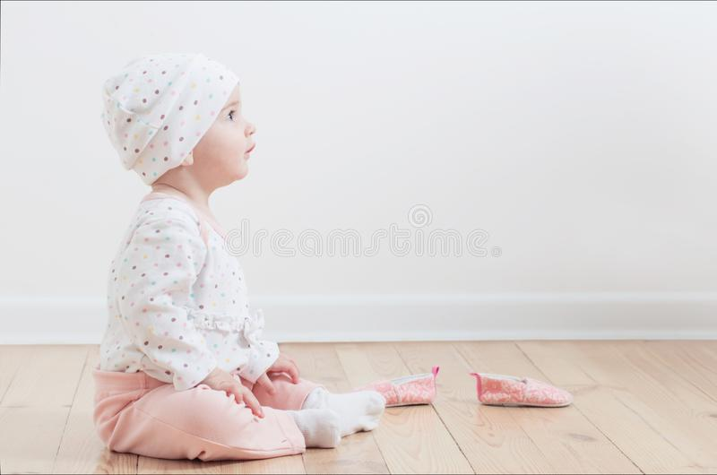 Funny beautiful baby on floor stock images