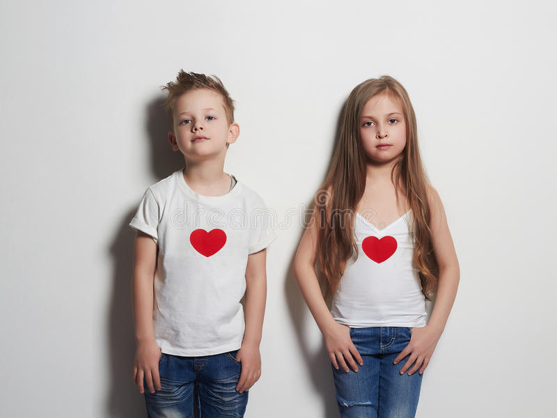 Funny beautiful couple. beauty little girl and boy together. Love,valentine,hearts royalty free stock photography