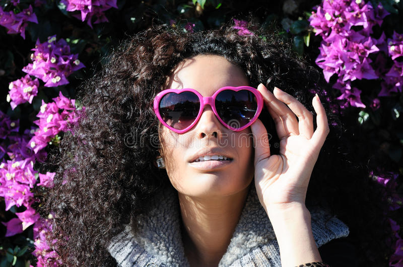 Funny black girl with purple heart glasses. Portrait of a funny black girl with purple heart glasses royalty free stock photos