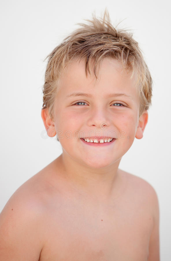 Funny blond boy looking at camera royalty free stock image