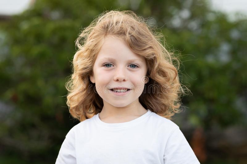 Funny blond kid with long hair royalty free stock photos