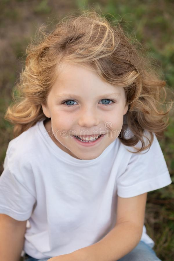 Funny blond kid with long hair royalty free stock photography