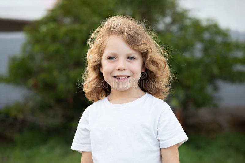 Funny blond kid with long hair stock photos